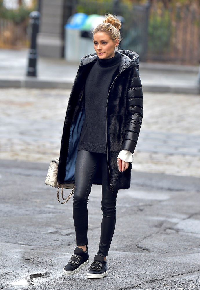 Olivia Palermo never puts a fashion step wrong. Case in point: this black puffer jacket, wet-look skinny jeans and embellished sneaker get-up.