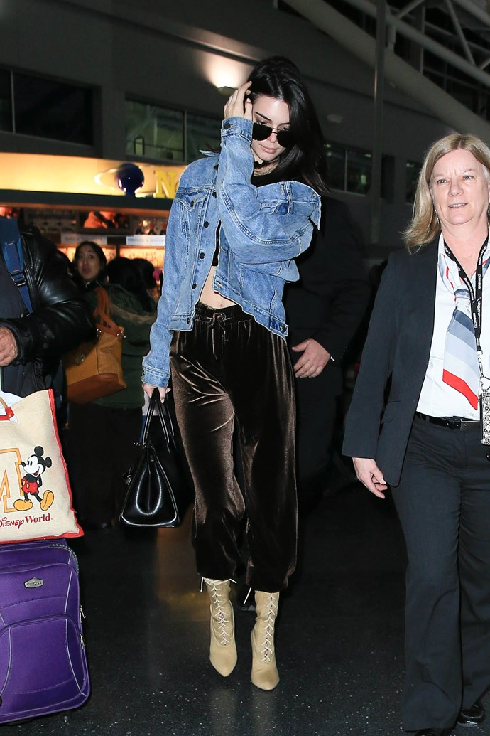 Kendall Jenner makes like her sisters and steps out in statement tracksuit pants before one of her long-haul flights.