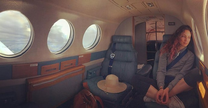 Here's Troian casually looking out the window in their PRIVATE JET.