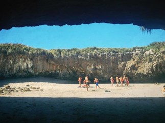 You have to swim underwater to find this hidden beach in Mexico