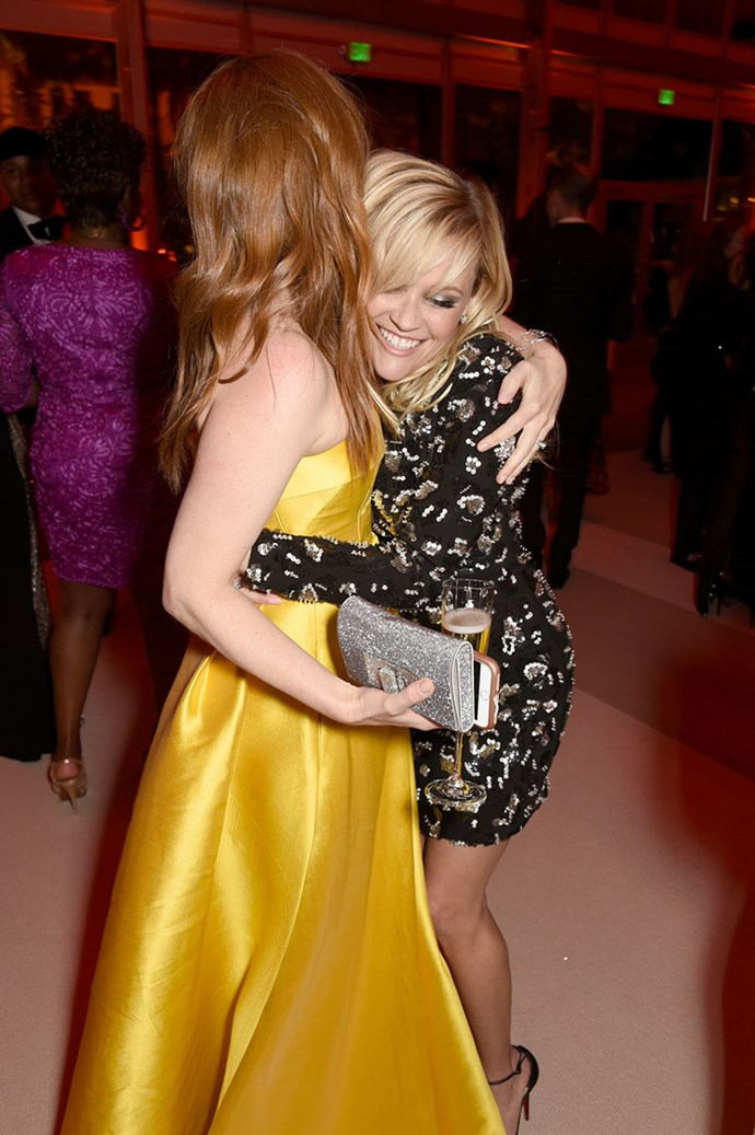 Reese Witherspoon squeezed Isla Fisher.