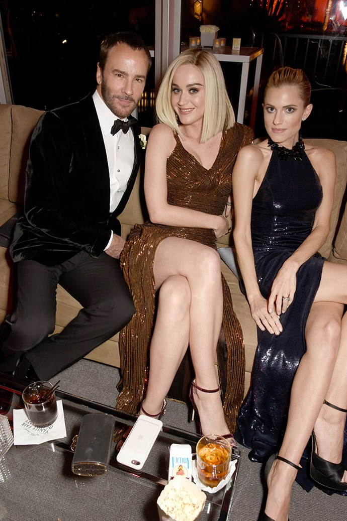 Tom Ford, Katy Perry and Allison Williams made a sexy trio at the *Vanity Fair* Oscars party.