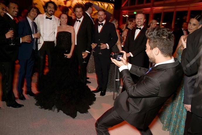 Dominic Cooper flexed his group photo-taking skills.