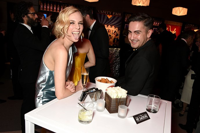 Diane Kruger tucked into the snacks at the *Vanity Fair* Oscars party.