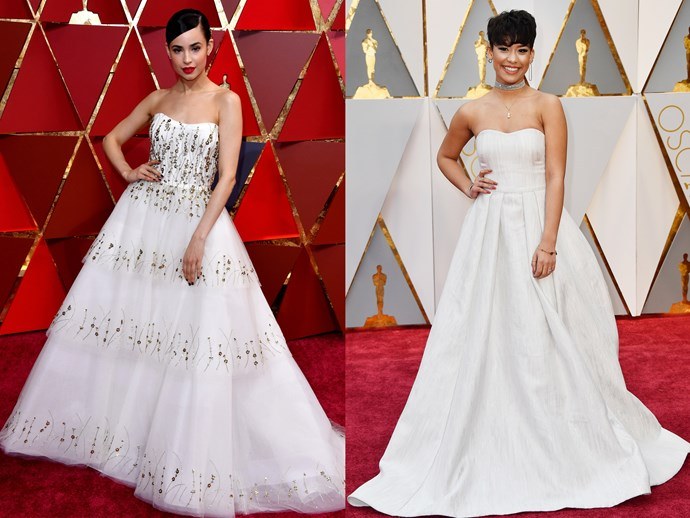 **Sofia Carson** and **Brianna Perez** in white strapless ball gowns with sweetheart necklines and full skirts.