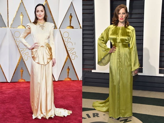 **Dakota Johnson** and **Liz Goldwyn** in cirtus-coloured satin dresses with long sleeves and high necks.