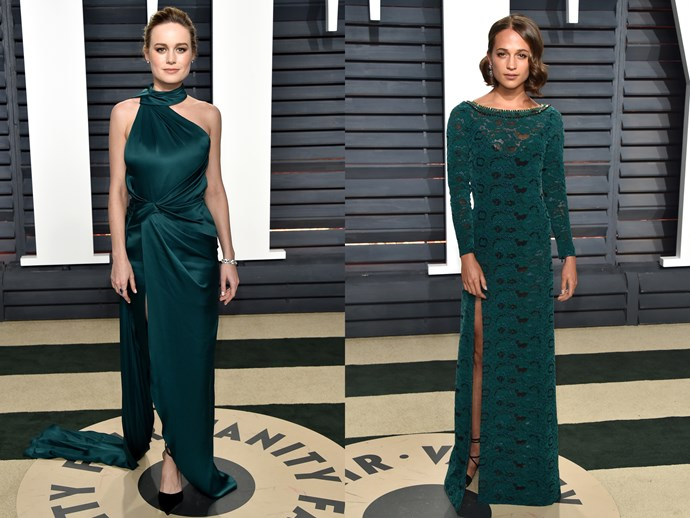 **Brie Larson** and **Alicia Vikander** in dresses in the same shade of dark teal with hip-high splits.