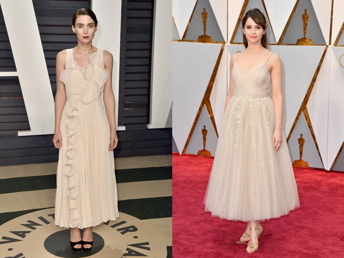 **Rooney Mara** and **Felicity Jones** in ankle-length oyster-coloured dresses with pleated skirts and side-swept fringes.