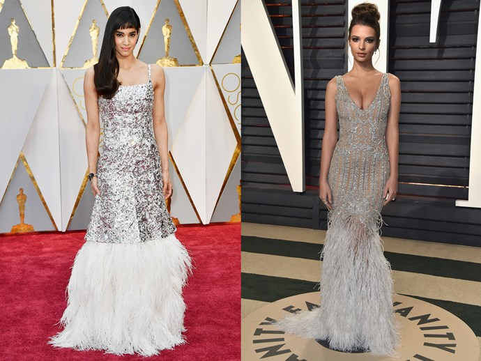 **Sofia Boutella** and **Emily Ratajkowski** in mermaid-style silver dresses with feathers in the skirt.