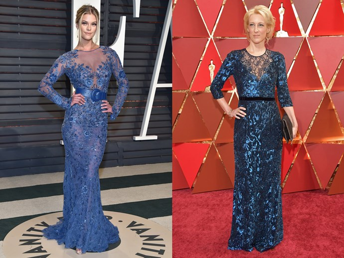 **Nina Agdal** and **Cara Speller** in long sleeved, high-necked blue gowns with sheer details and a belted waist.