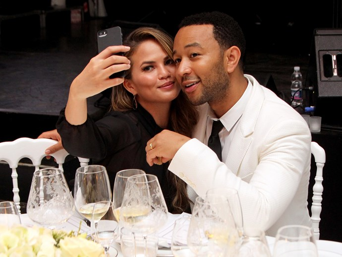 Chrissy Teigen shuts down a Twitter hater that hopes she and John Legend will split