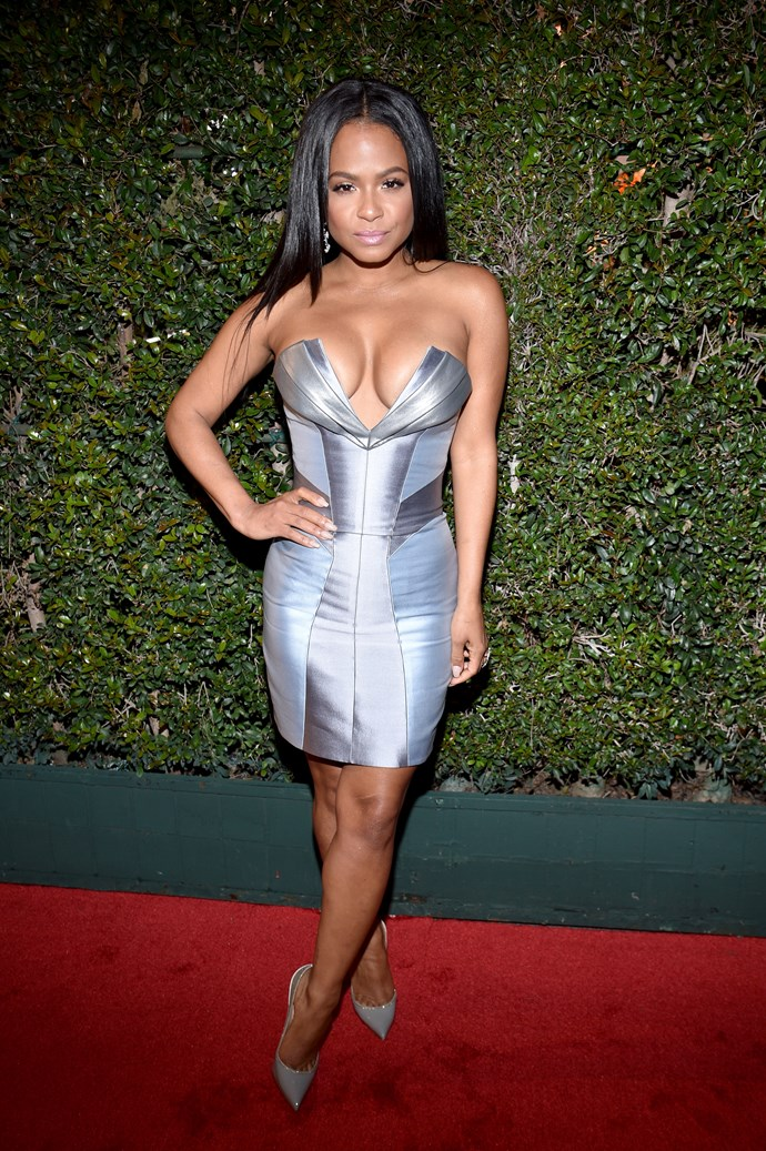 Christina Milian wore a show-stopping silver mini and by god does her figure look amaze.