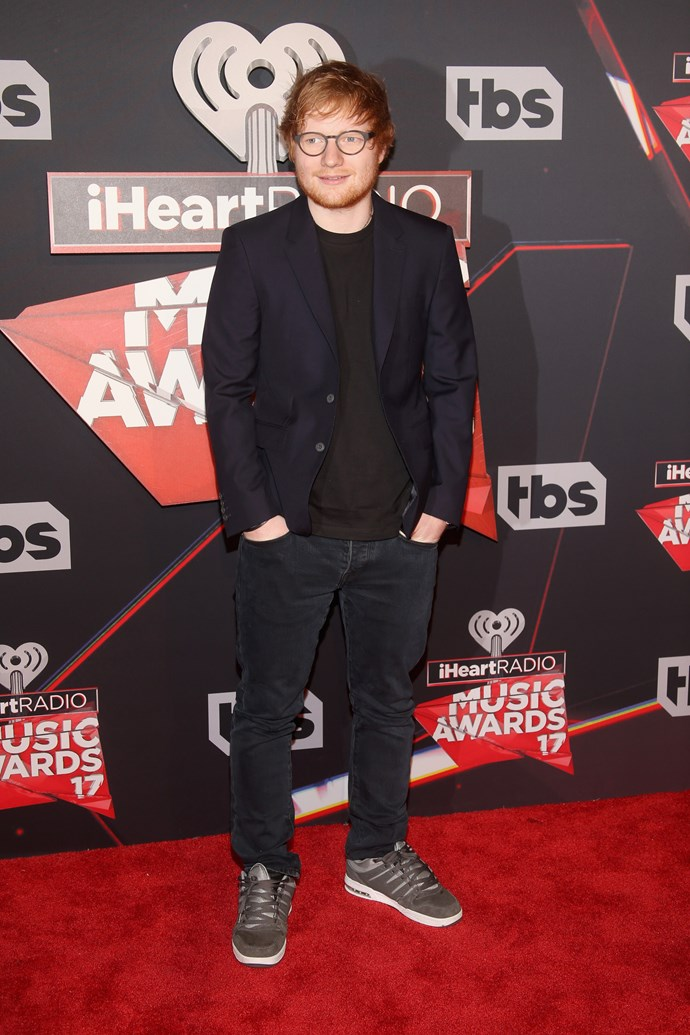 Ed Sheeran kept things cool-casual in jeans and sneaks, with a blazer thrown over the top.
