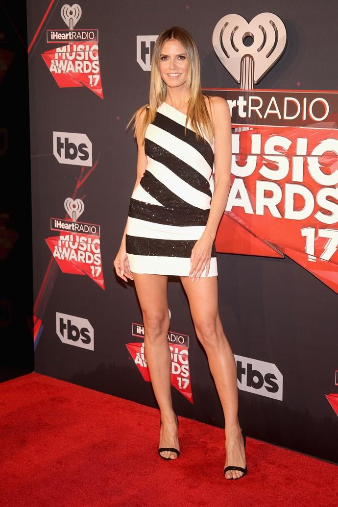 Heidi Klum looks frekkin' INCRED in this low-key striped mini dress 'cause Heidi.