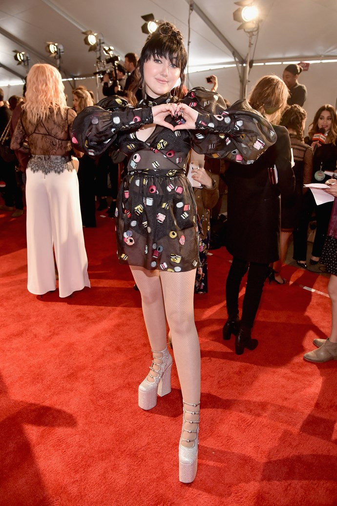 Noah Cyrus *also* made like her older sis Miley, repping some killer heels and a quirky, sheer Liquorice All Sorts-inspired mini.