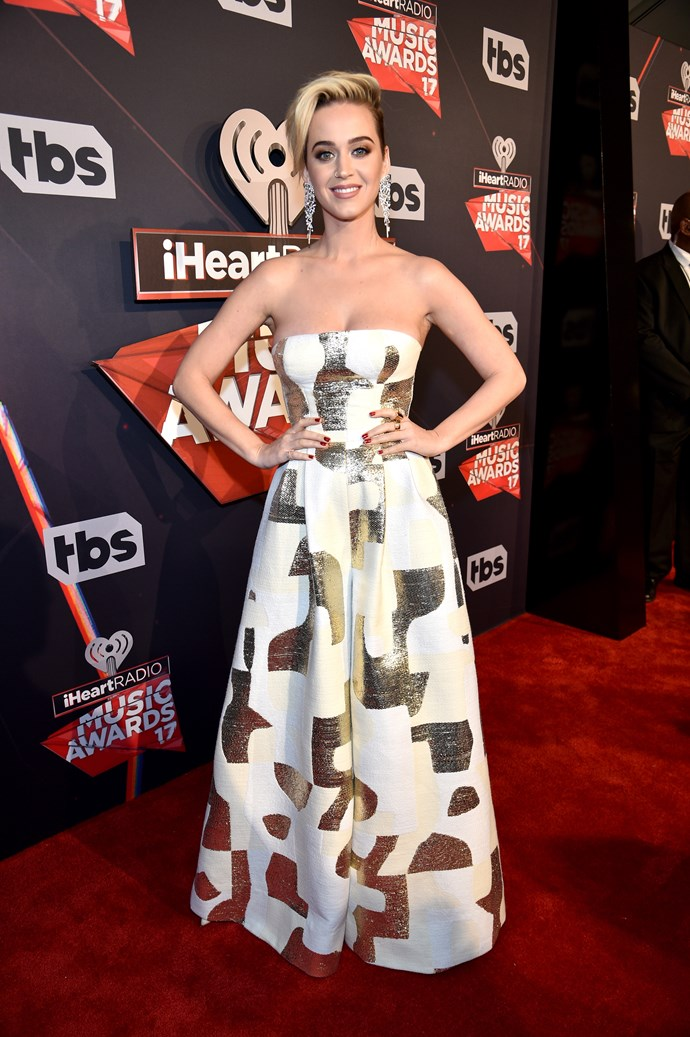 Katy Perry channeled Miley Cyrus with her new ~edgy~ pixie cut, teamed with this artsy strapless gown.
