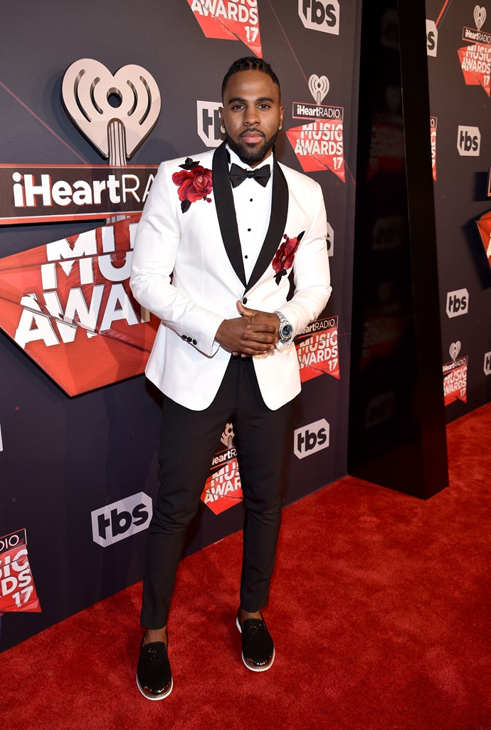 Jason Derulo wore a monochromatic tux with ginormous flowers whacked on the front and we're totally here for it <33.