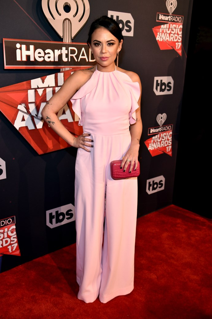 *PLL*'s Janel Parrish looked *beyond* chic in this frilly, fairy-floss jumpsuit.