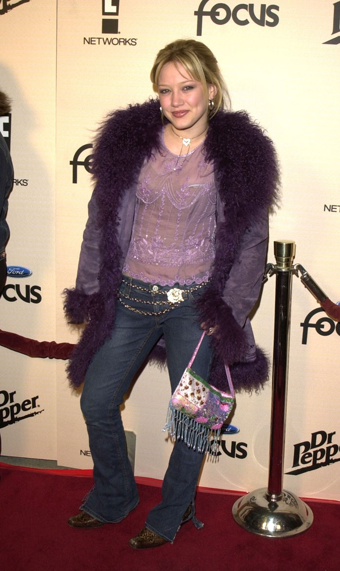 The kween of sass schooled us on how to wear purple fur like it ain't no thang.