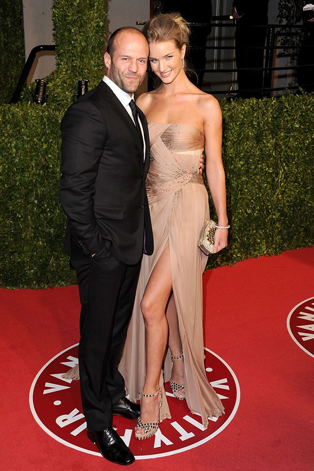 **Jason Statham and Rosie Huntington-Whiteley**  At the *Vanity Fair* Oscars party in February 2011.