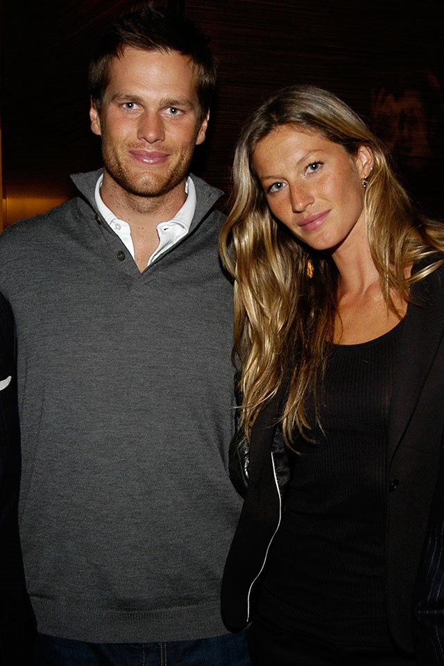 **Tom Brady and Gisele Bündchen**  At a store opening in March 2008.