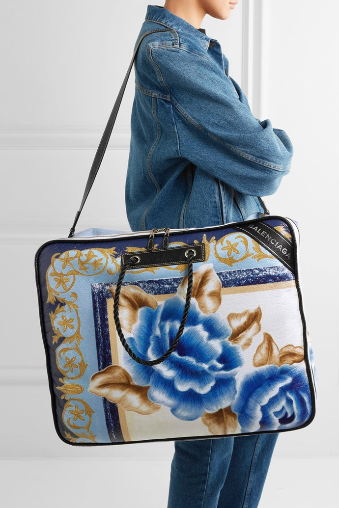 "Serious question: Why does a [bag](https://www.net-a-porter.com/au/en/product/873861/balenciaga/blanket-printed-textured-leather-tote|target=""_blank""
