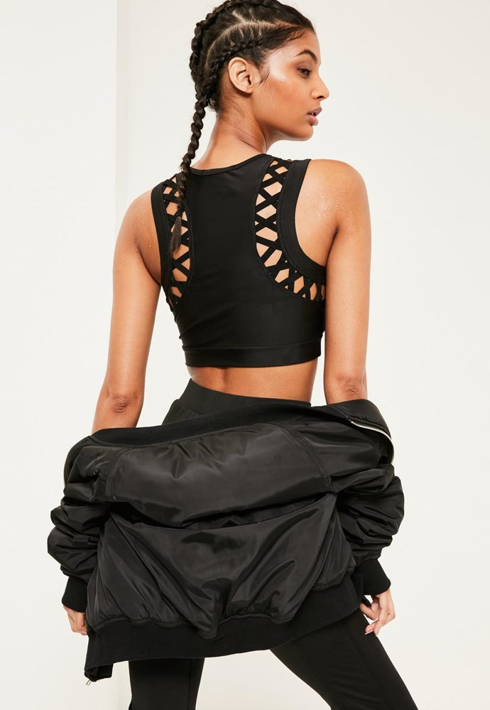 Anyone else getting MAJOR Kylie Jenner vibes? Active Black Cross Detail Crop Top, $26.95, [Missguided](https://www.missguidedau.com/active-black-cross-detail-crop-top)