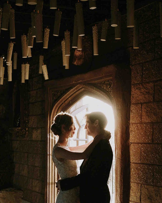 """Custom candles were made to hang from the ceiling, just like The Great Hall.   [Nirav Patel Photography](http://niravpatelphotography.com/