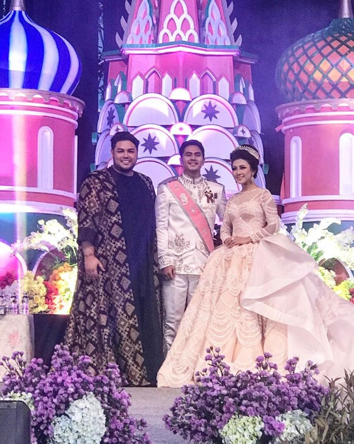 The ceremony backdrop was a castle (because of course it was). While we're not sure what the inspiration was behind this backdrop, we will say the pink pops perfectly against Gunawan's sash.