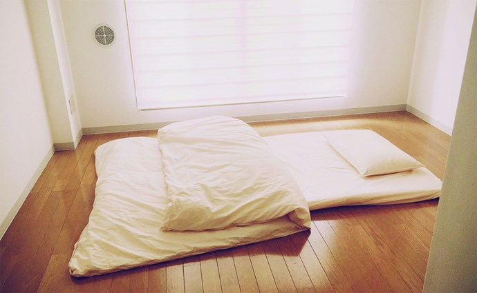 In the mornings, Sasaki wakes without an alarm and puts away his futon pad.