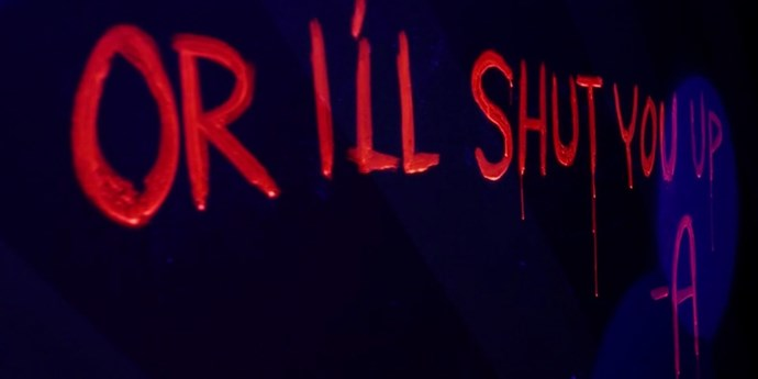 """**Carnival hell pt. 2**  The full message reads, """"Shut up or I'll shut you up."""" Subtle!"""
