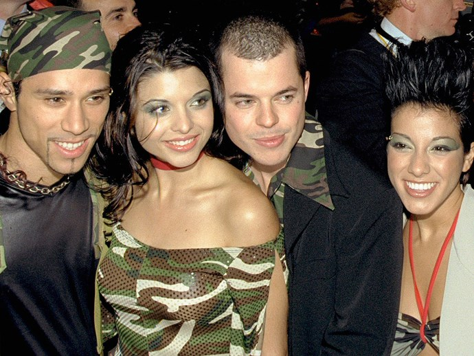 **Aquatic makeup**  By far the best image in this gallery. Scandal'us. The winners of *Popstars* in 2001. In green fish-scale eye shadow and matching army camouflage.  *Scandal'us, 2001.*