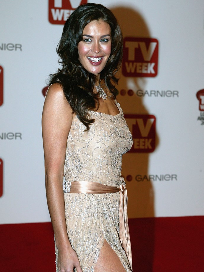 **Minimal**  Megan Gale was and always will be hair goals.   *Megan Gale, 2004.*