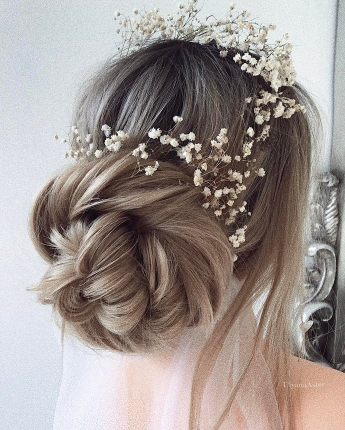 Secure your veil underneath your updo to show off your beautiful bun.
