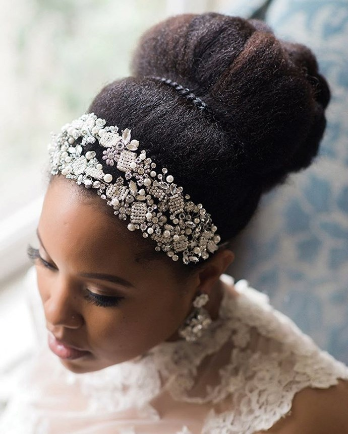You can never go wrong with sweeping your natural hair into a glamorous updo and then adding a bejeweled headband that'll take your look to a whole new level.