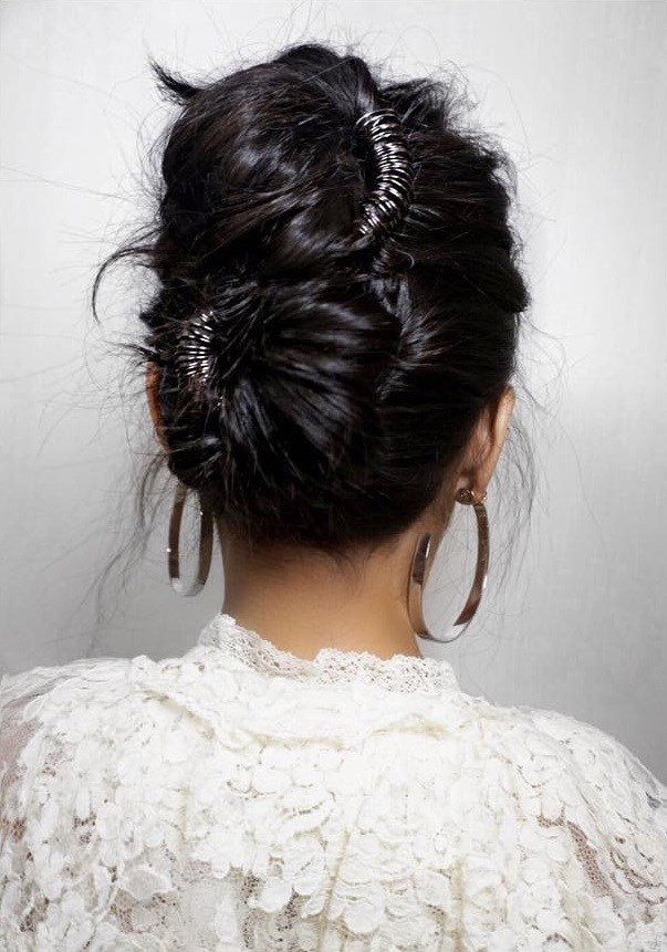 If the vibe you want for your updo is more cool than classic, try wrapping your hair into twin chignons like this.