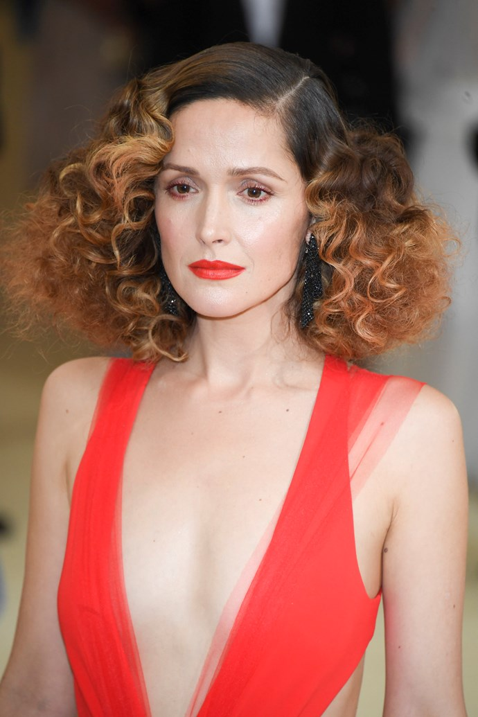 Somehow, Rose Byrne makes this crazy perm sitch look strangely chic.