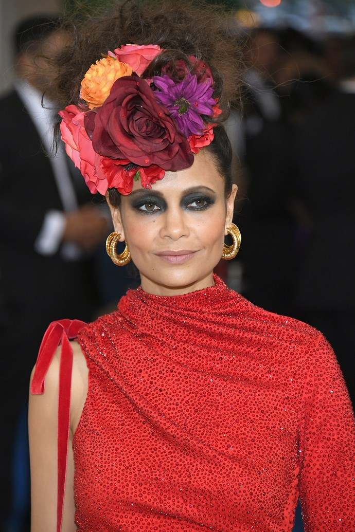 English actress Thandie Newton accessorised her beehive hairstyle with every flower from my grandma's front garden.