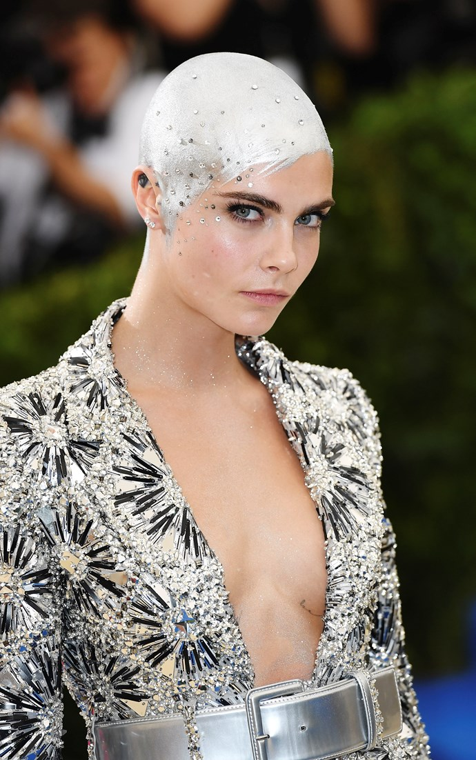 Another helmet! This time, Cara Delevingne painted her freshly shaved head a luminous shade of silver.