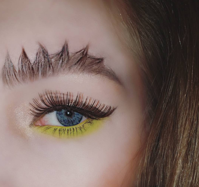 "**Dragon Brows** <br><br> Barbed-wire brow's feistier sister. The spiky design is inspired by the dragon's spine in Xbox game, Skyrim. Yes, we are serious. Eyelash glue is used to get the points super fine.  @[Harlibi](https://www.instagram.com/p/BThm0t9jIXG/?taken-by=harlibi|target=""_blank""