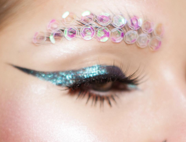 "**Sequin Brows** <br><br> Probably the easiest look of the lot. A little fake eyelash glue and two rows of holographic sequins are a festival beauty win.    @[Wintervea](https://www.instagram.com/p/BSEUIjMjREc/?taken-by=wintervea|target=""_blank""