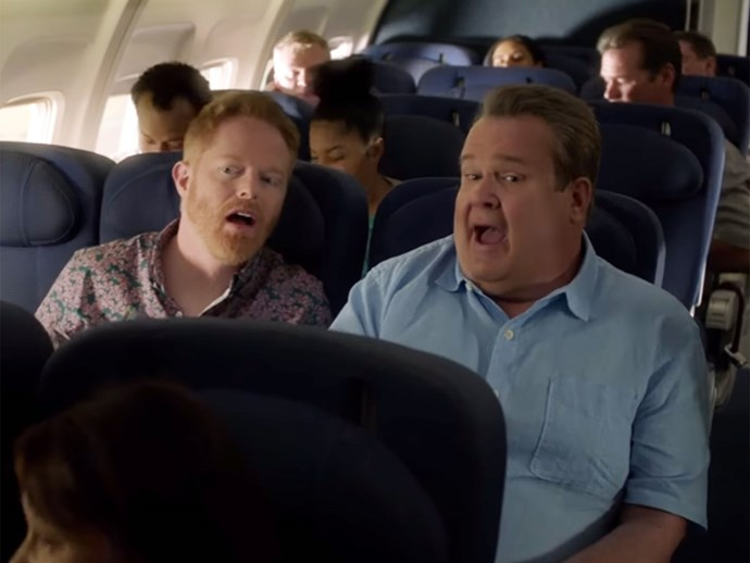 Cam and Mitchell Modern Family plane scene