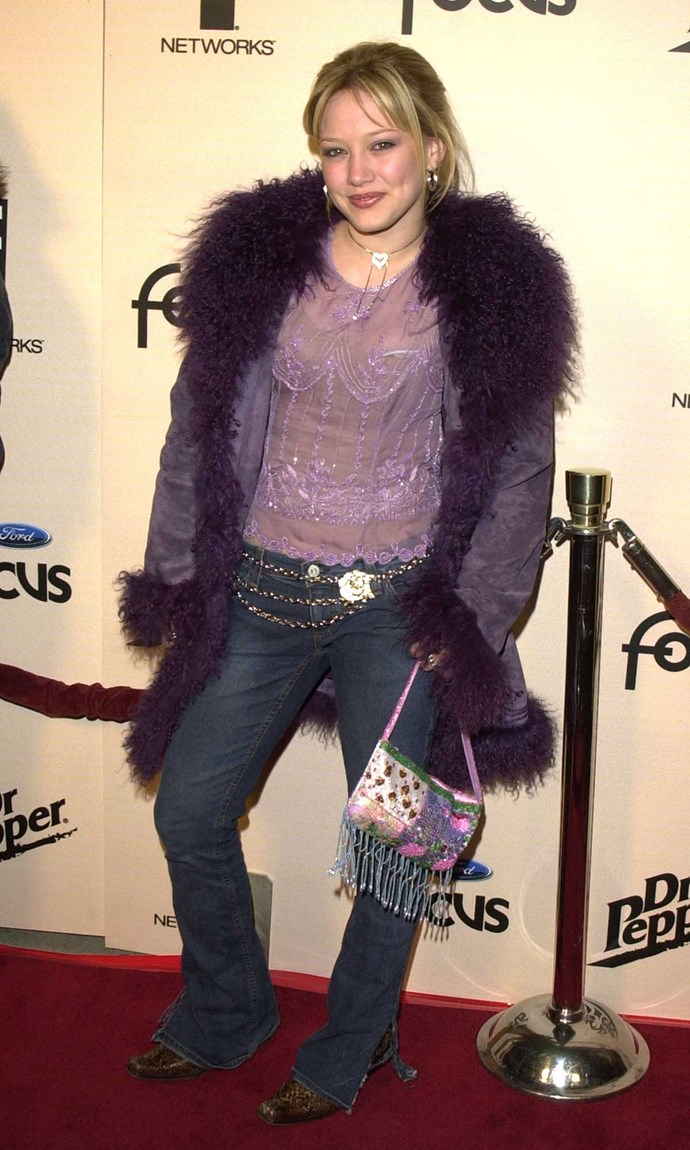 **9. The Nickelodeon Star:**  Blingy belts, bootleg jeans and glitzy tops were your go-to, accessorized with a baguette bag, butterfly clips and shittonnes of glitter.