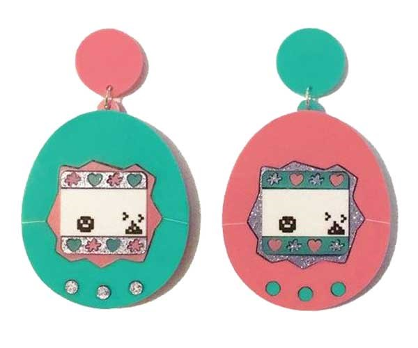 ZOMG TAMAGOTCHI 😱 Earrings, [$50](https://www.yippywhippy.com/products/virtual-pet-earrings)