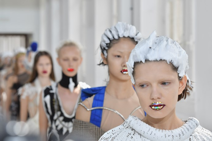 Hairstylist Eugene Soulemain covered the models' hair at Maison Margiela in streaks of styling foam and heavy glitter.