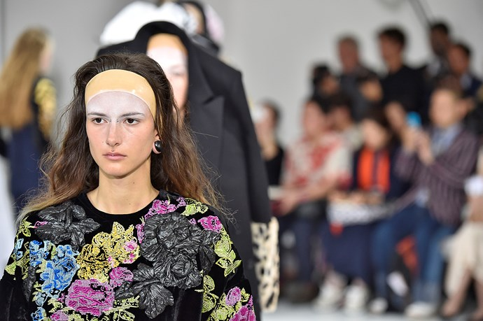 Then makeup whizz Inge Grognard dusted white MAC powder across the models' foreheads.
