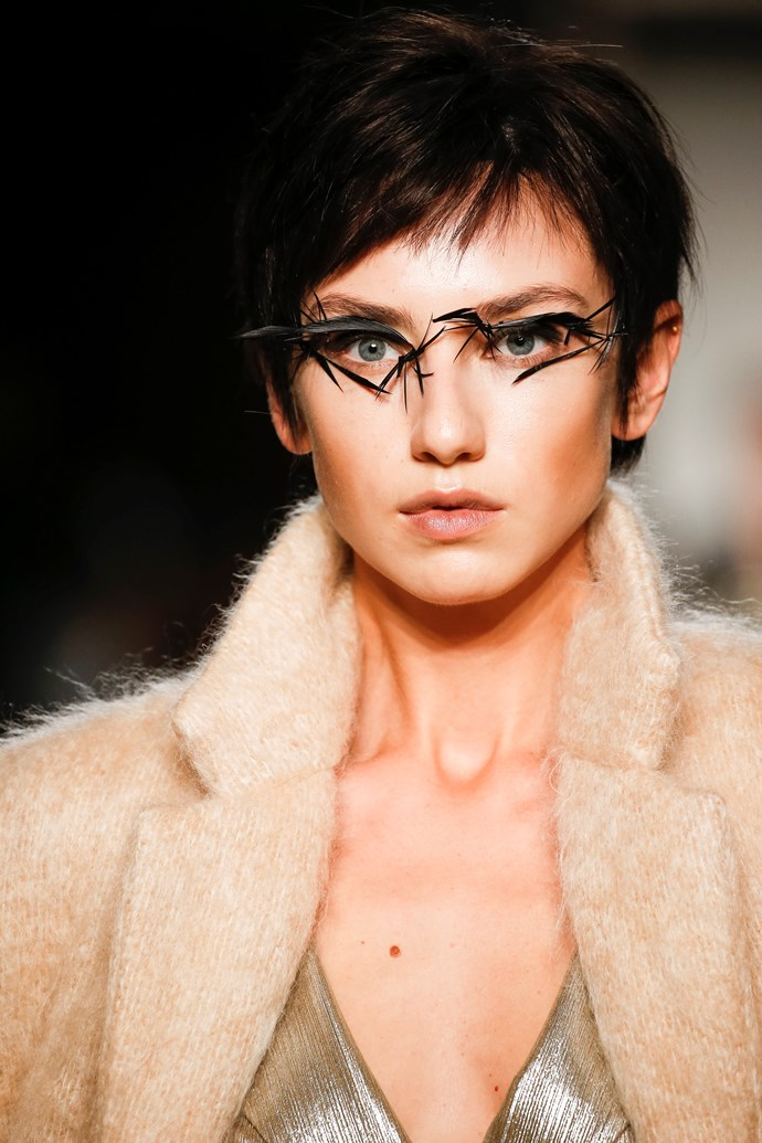 Makeup artist Nicolas Degennes adorned the models' eyes with feathers for the Julien Fournie show.