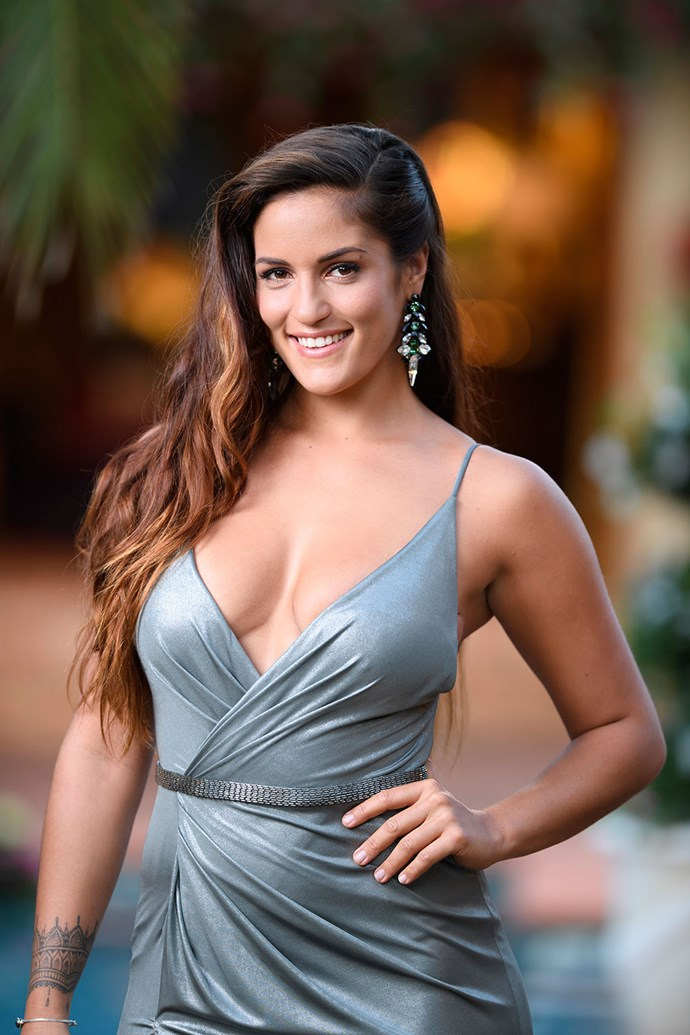 """**Elora** <br><br> Elora, 27, is a Tahitian-born babe who works as a **personal trainer**. She's the one with the """"mysterious"""" and """"exotic"""" edge, and her entrance will be """"fiery"""" and """"unforgettable."""" Pretty sure we know which one she is."""