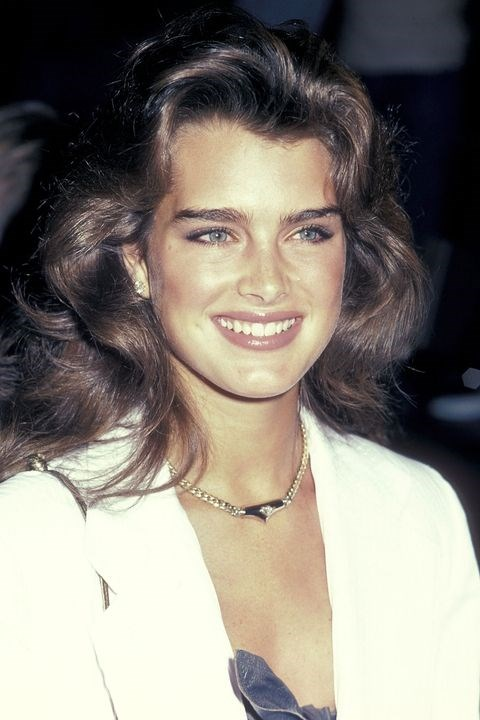 **1983: The bigger, the better** <br><br> Voluminous hair had a different meaning in the early '80s. Not only do Brooke Shields' waves stretch up high, they also reach out wide.