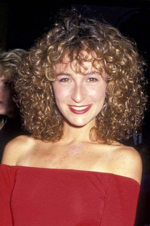 **1987: Curly bangs** <br><br> No one puts Jennifer Grey's bangs in the corner (sorry!). They're front and centre, blending right in with her luscious curls.